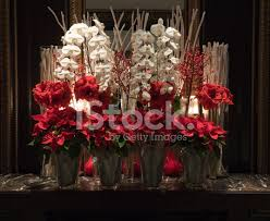 poinsettia and white orchid flower arrangement stock