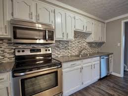 how to professionally paint cabinets white how to paint cabinets the right way the flooring