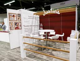 tradeshow booth meeting space with natural wood accents and vinyl