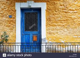 blue front door in yellow house front pelion peninsula thessaly