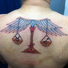 winged libra zodiac scale on upperback libra tatto