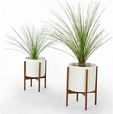 oversized planters are great for the patio using greenery is