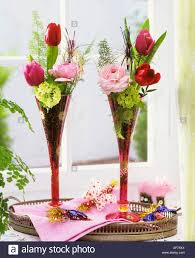 new years chagne flutes flowers in chagne flutes on a tray for new year stock photo