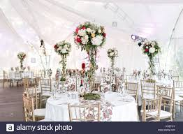 wedding flowers for guests interior of a wedding tent decoration ready for guests served