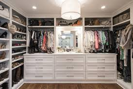 elegant white walk in closet with built in dressing table by james