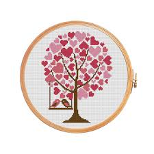 tree of hearts with birds on a swing in a