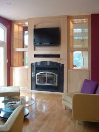 birds eye maple built in entertainment center with fireplace contemporary living room