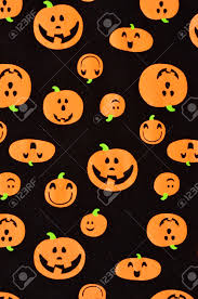 halloween orange pumpkins on black fabric cute scary smiling