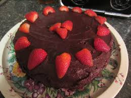 moist chocolate cake with chocolate chip frosting and raspberry