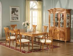 light brown polished teak wood dining table with turned legs and