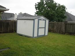 tough shed design with vinyl coated steel shed and large backyard