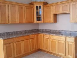 brown wooden corner kitchen pantry cabinet with grey marble