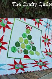 quilted christmas deck the walls with a quilted christmas wall hanging make it coats