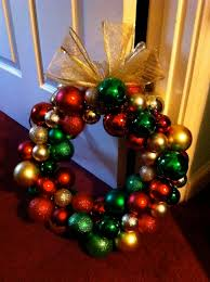 diy christmas wreath dollar store ornaments strung through a coat