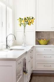 gray glazed white kitchen cabinets gray glazed cooktop tiles transitional kitchen