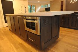 marble countertops kitchen island with microwave lighting flooring