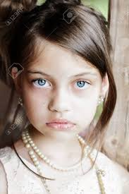 girl pearl necklace images Young girl looking directly into the camera wearing vintage jpg