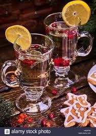 christmas cookies plate and two glasses mug with cinnamon sticks