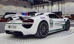 electric porsche 918 dubai police adds porsche 918 spyder to its growing supercar lineup