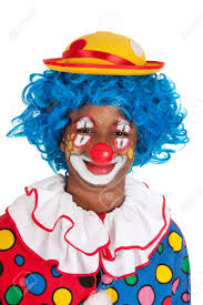 portrait of a funny black clown with blue hair stock photo