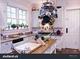 spacious modern kitchen pot rack island stock photo 123000988