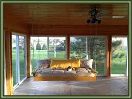 Patio Swing Frame by Ergonomic Porch Swing Beds With Yellow Wooden Frame In Wooden Sunroom Jpg