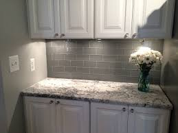 grey glass subway tile backsplash and white cabinet for small