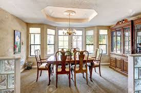 elegant dining room interior with brown table and chairs stock