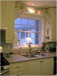 kitchen sink ideas over the kitchen sink shelf with paper towel holder above the