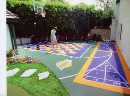 Basketball Court In The Backyard His Pro Dunk Gold Basketball System Sits Nicely Beside The