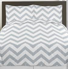 bedroom grey and teal chevron bedding large limestone wall