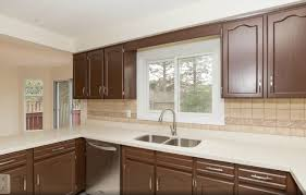 cabinet refinishing spray painting and kitchen cabinet spraying cabinets hvlp painted after 6 realtor cabinets full