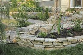 rock garden waterfall stream and stacked stone walls stock photo
