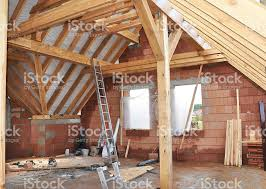 building an a frame cabin building attic interior wooden roof frame house construction stock