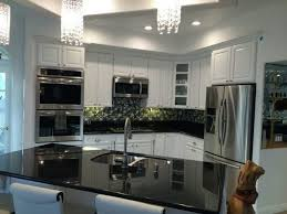 black kitchen countertops with white cabinets black galaxy granite with white cabinets backsplash ideas