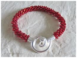 beaded red bracelet images Glowing dark ruby red beaded braided woven kumihimo seed bead png