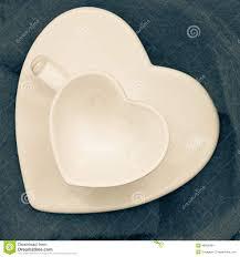 Heart Shaped Mug by Empty Tea Coffee Cup Mug On Saucer Heart Shape Stock Photo