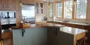 lighting white wooden kitchen island black stainless steel