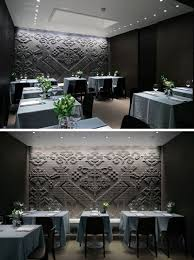 chiseled stone tapestries cover the walls of this restaurant in