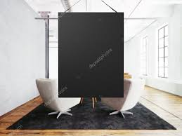 photo empty black canvas hanging in center of meeting room