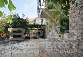 two stone houses with courtyard and sea view for sale postira