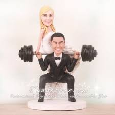 weight lifting cake topper doing squat sitting on barbell cake toppers