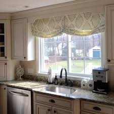 relaxed roman shade pattern beautiful relaxed roman shades in a kitchen window adds softness