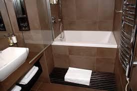 bathroom master bath with white brick shower walls narrow