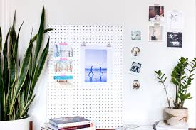 hang art 5 ways to hang art keep your walls hole free parabo press
