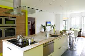 grandiose ceiling chimney hood over large kitchen island with sink