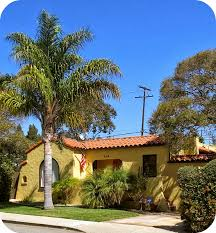 spanish revival colors spanish style homes with red roof in the front yard and the