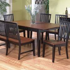 square brown wooden dining table with bench having back and black