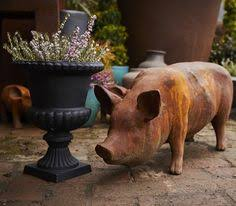 sitting pig statue cast iron rust finish garden ornament cast