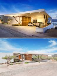 this home has a covered carport with a rammed earth feature wall